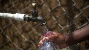 a child fills a bottle with water from a public tap in Colombia on March 22 2013 300x168